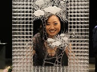 Eunsuh Choi poses with her face framed by one of her scultpures