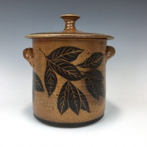 Lidded crock decorated with leavesby Terry Plasket