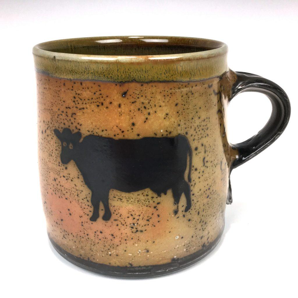 Cylinadr mug with a cow