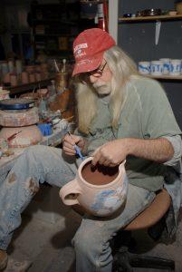 Terry Plasket decorating bisque ware pots