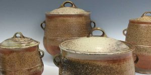 4 lidded wood fired, stoneware pots in natural brown