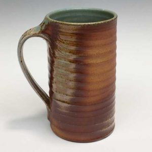 Wood-fired Tall Mug Approximately 6″ tall, 3.5″ cylinder diameter.